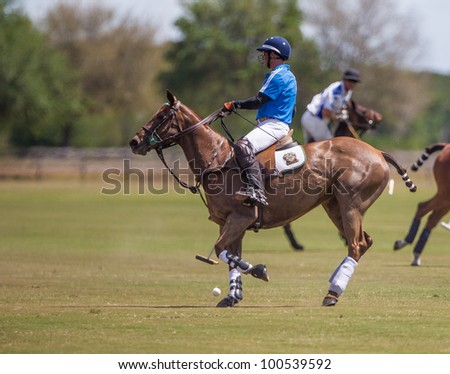 LAKEWOOD RANCH, SARASOTA, FLORIDA - Hillcroft polo player Stewart Campbell controls ball during the MGA Insurance Group Cup, a U.S.P.A. Regional Classic Final,  on March 18, 2012 in Sarasota, Florida