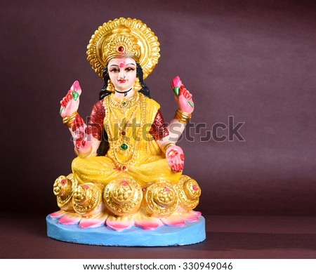 Lakshmi - Hindu goddess ,Goddess Lakshmi. Goddess Lakshmi during Diwali Celebration. Greetings Card Design Indian Hindu Light Festival called Diwali - stock photo