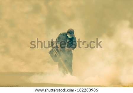 Laksi,Bangkok, THAILAND - March 11 : The unidentified officer is spraying chemical for an outbreak of dengue fever on March 11 , 2014 in Laksi , Bangkok, Thailand.