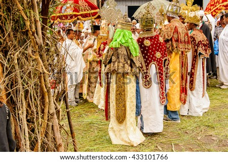 LALIBELA, ETHIOPIA - SEP 27, 2011: Unidentified Ethiopian group of people wathing the religious festival Meskel in Ehtiopia, Sep 27, 2011. Meskel commemorates the finding of the True Cross