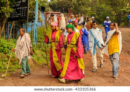 LALIBELA, ETHIOPIA - SEP 27, 2011: Unidentified Ethiopian people in bright clothes come to the Meskel festival in Ehtiopia, Sep 27, 2011. Meskel commemorates the finding of the True Cross