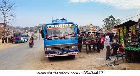 Lamahi, Nepal - 5 February 2014: A long-distance bus headed for Nepalgunj takes a rest break in Lamahi bus park in the Terai region - stock photo