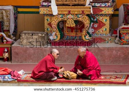 LAMAYURU, INDIA - JUNE 13, 2015: Unidentified two buddhist monk during mystical mask dancing Tsam mystery dance in time of Yuru Kabgyat Buddhist festival at Lamayuru Gompa, Ladakh, North India - stock photo