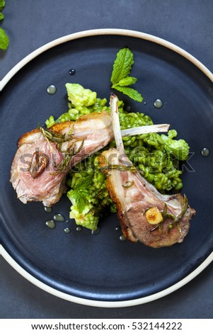 Lamb chops with green risotto with peas, romanesco cauliflower and mint