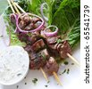Lamb kebabs with tzatziki cucumber yogurt.  On kos lettuce, with red onions. - stock photo