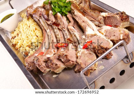 Lamb ribs with couscous - stock photo