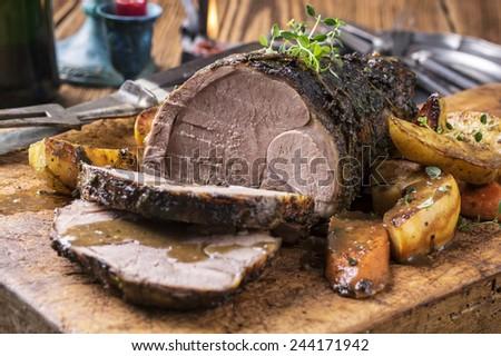 Lamb Roast on a Chopping Board - stock photo