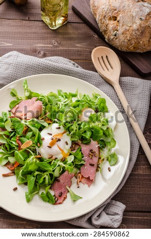 Lamb's lettuce salad with roasted nuts, smoked rump and poached egg ...