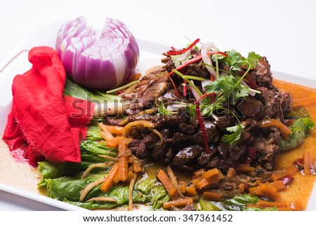 Lamb shank braised in an onion jus. - stock photo