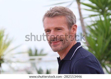 Lambert Wilson, Master of Ceremonies, attends a photocall during the 68th annual Cannes Film Festival on May 13, 2015 in Cannes, France. - stock photo
