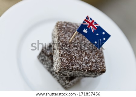 lamingtons on a white plate with an australian flag - stock photo