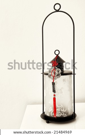 Lamp and Chinese lucky coins - stock photo
