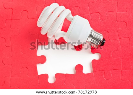 Lamp and red puzzle - concept creativity background