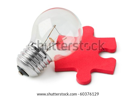 Lamp and red puzzle isolated on white background