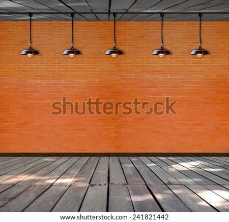 Lamp at brick wall background with ground wood - stock photo