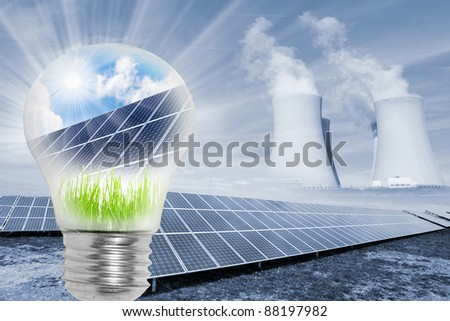 Lamp bulb with solar panels. Conceptual image. Environmental metaphor. - stock photo