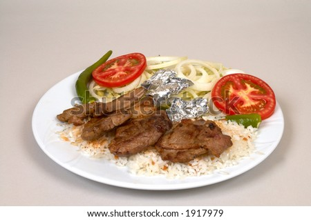 Lamp chops with rice and salads - stock photo