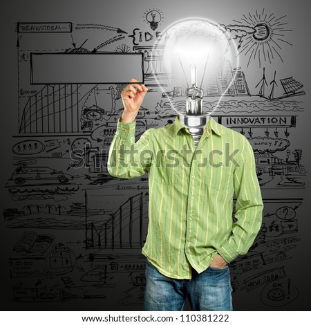 Lamp head male writing something on glass board with marker - stock photo