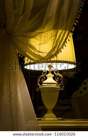 Lamp in the dark interior - stock photo