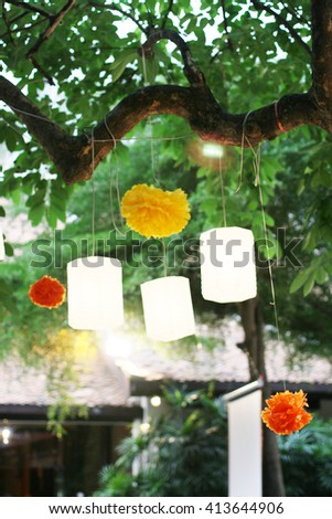 lamp light deccorate and hanging on tree background - stock photo