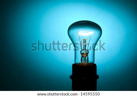 Lamp on a dark blue background - stock photo