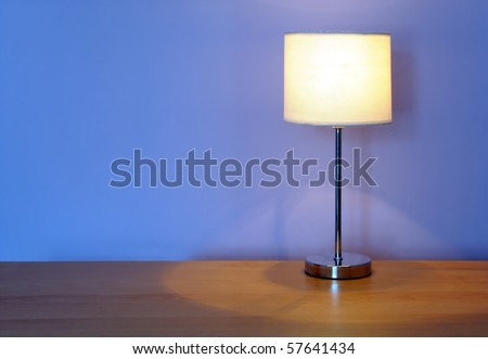 lamp on a wooden desk, with space for your text / editorial overlay - stock photo