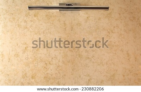 Lamp on beige wall background - stock photo