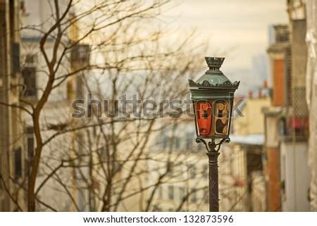 Lamp on Montmartre against Paris. - stock photo