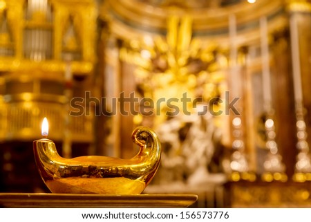 lamp on the background of the altar in St John's Co-Cathedral in Valletta in Malta - stock photo