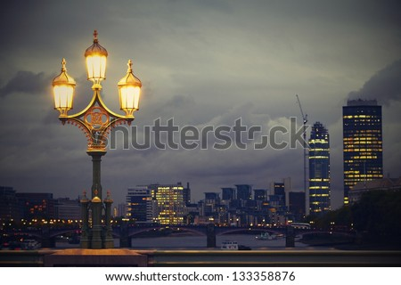 Lamp on the Westminster bridge, London, UK - stock photo