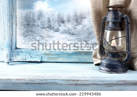 lamp on window sill of blue  - stock photo