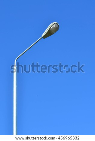 Lamp post against blue sky background - stock photo