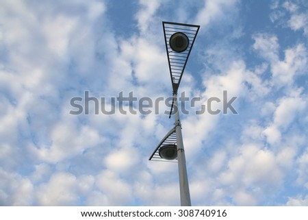 Lamp post and the cloud - stock photo