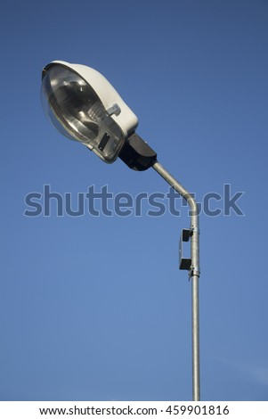 lamp post electricity industry with blue sky - stock photo