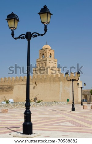 Lamp post in front of Great Mosque of Kairouan Tunisia africa - stock photo