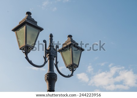 Lamp post in the sky - stock photo