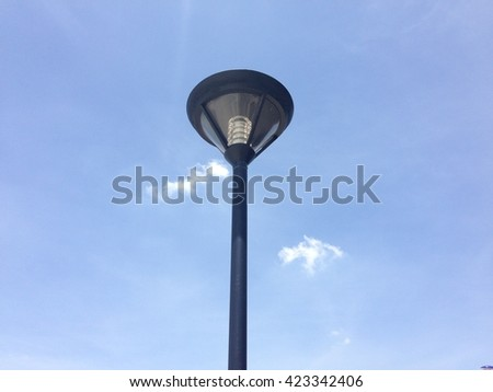 lamp post is middle of clear sky - stock photo