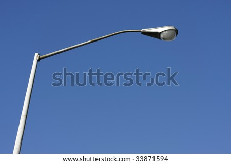 lamp post isolated on blue sky - stock photo