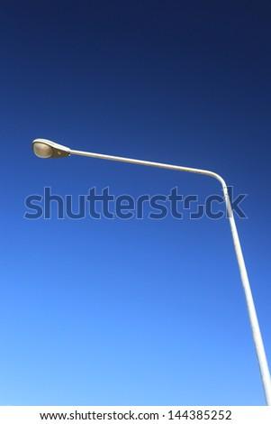 Lamp Post Street Road over blue sky - stock photo