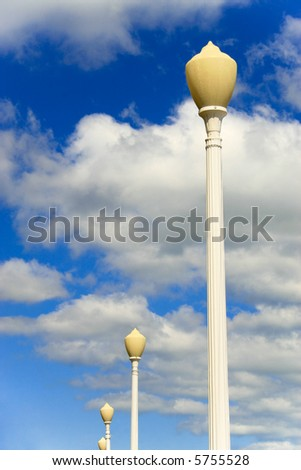 Lamp posts with cloudy sky - stock photo