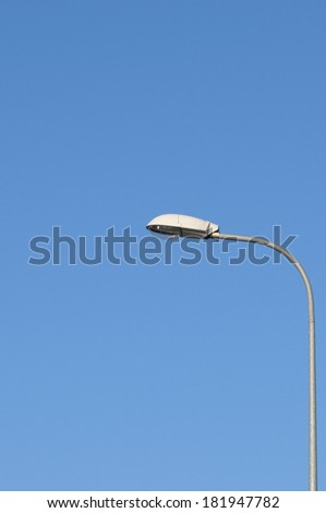 Lamp street lighting on the background of blue sky. - stock photo