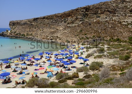 LAMPEDUSA, ITALY - JULY 05: Some boats near the beach Spiaggia dei Conigli, the most beautiful beach in the world according Travelers Choice Awards list, on July 05, 2015, in Lampedusa, Italy