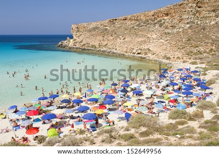 LAMPEDUSA, ITALY - JULY 16: Some tourists in the beach Spiaggia dei Conigli, the most beautiful beach in the world according Travelers Choice Awards list, on July 16, 2013 in Lampedusa, Sicily, Italy.