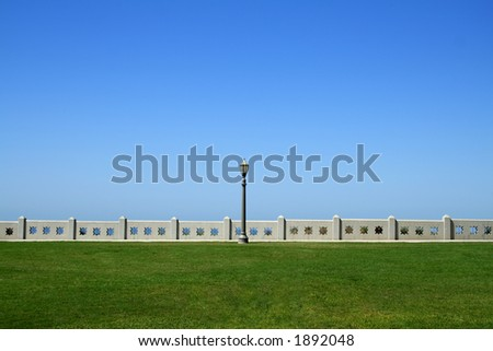 Lamppost Between Land and Sky - stock photo