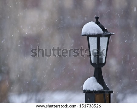 Lamppost covered with snow - stock photo