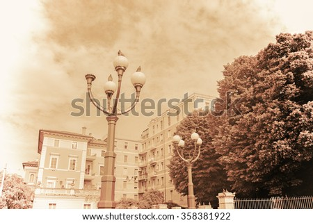lamppost in vintage tone in Bologna, Italy - stock photo