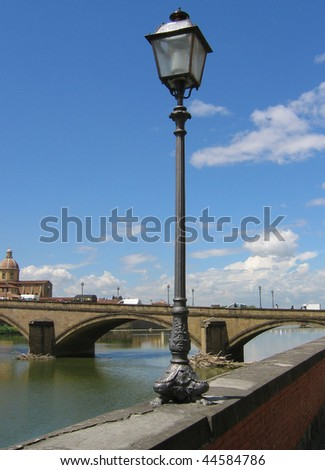 Lamppost on the embankment of the river Arno. Florence. Italy. - stock photo