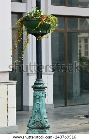Lamppost with flower pot - stock photo