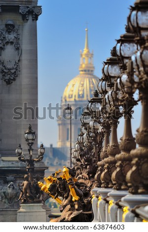 Lampposts on the bridge and the golden Dome of the Cathedral - stock photo