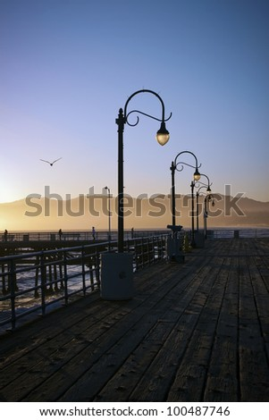 Lampposts on the Santa Monica Pier in California at sunset. - stock photo